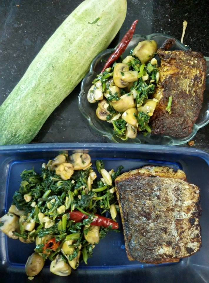 Fish with a side of mushrooms and spinach.